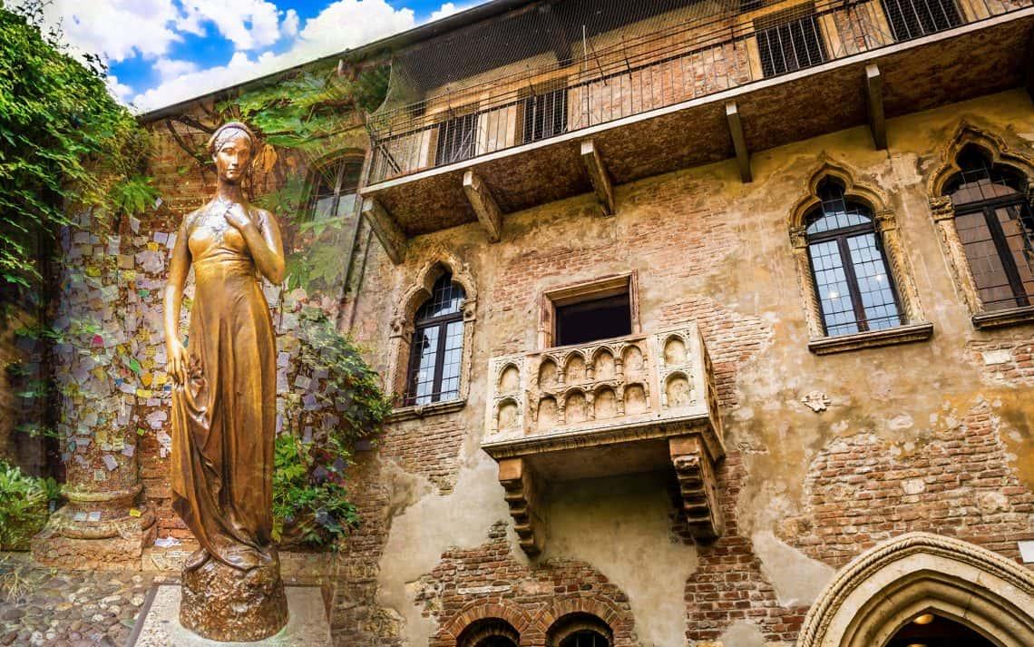 statue of Juliet in front of her house in Verona